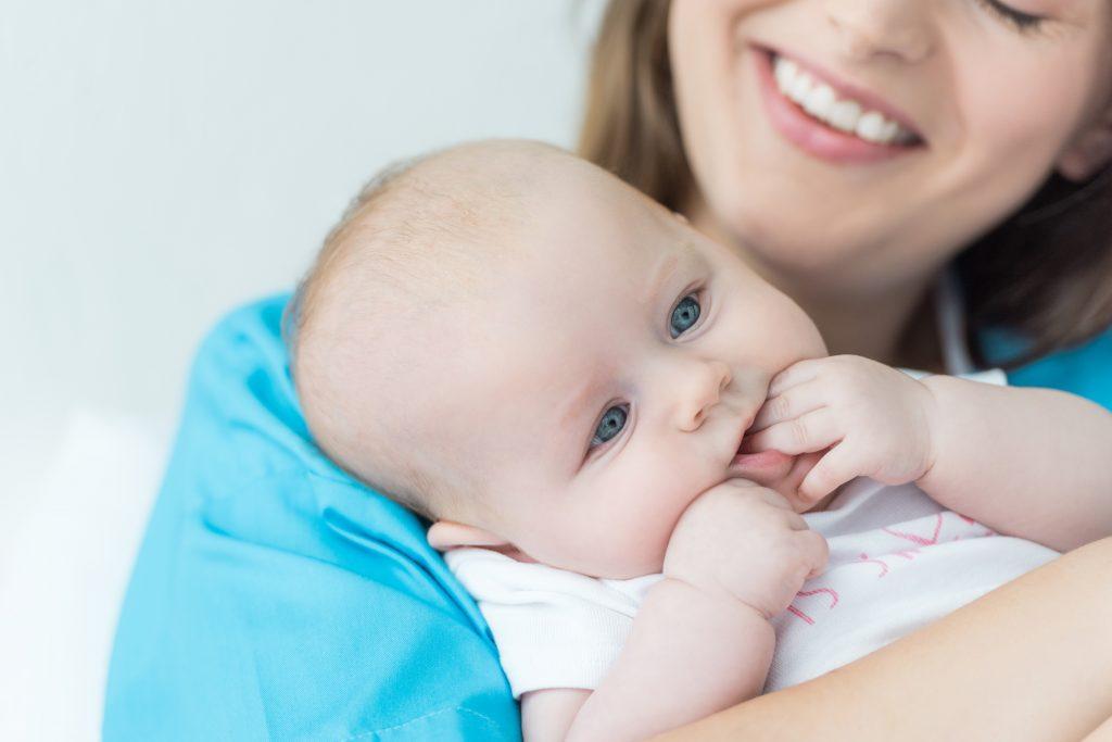 White female holding infant